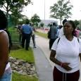 Women wait outside the Reliant Center / Astrodome in Houston.
