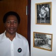 Local 743 Vice President Larry Davis stands next to historical photos of members