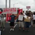 "The powerful slogan ""Chicano power"" was heard here as marchers headed down Whitt"