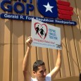 Immigrant rights protester outside Republican Party headquarters.