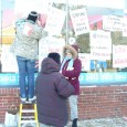 Protesters against NDAA duct tape signs to front of Obama campaign headquarters.