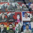 Faces of martyrs on a wall in Homs