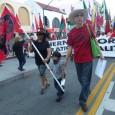 Veteran Chicano leader Carlos Montes at LA May Day march.