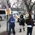 winter picketers with purple SEIU signs