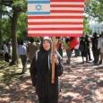A Muslim woman protesting U.S. complicity in Israeli war