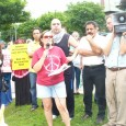 Meredith Aby-Keirstead, of the Anti-War Committee speaking at July 11 protest.