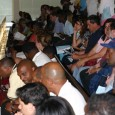 Workers and community members pack the General Assembly in protest of the budget