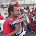 A FLOC organizer leads chants on the bullhorn