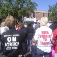 "NW workers with ""strike"" tshirts"