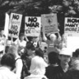 Crowd with signs at D.C. anti-war march.