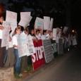 Students protest outside John Ashcroft speech.