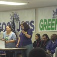 A member of the negotiating committee speaks at the strike vote meeting