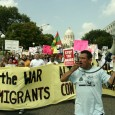 Protesters with banner: STOP THE WAR ON IMMIGRANTS.