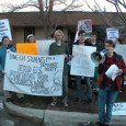 A photo of protesters in front of David Price's Chapel Hill office.